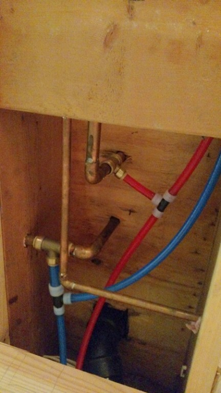 Rough Plumbing Connected To The Existing Supply Lines In The Ceiling